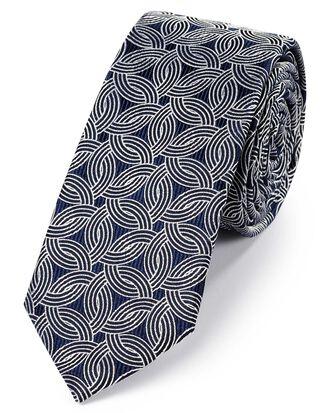 Cravate slim bleu marine et blanche en soie à motifs géométriques