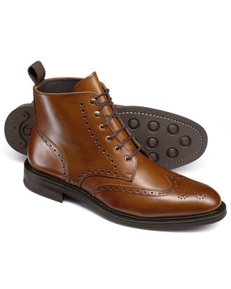 Tan brogue wing tip boots