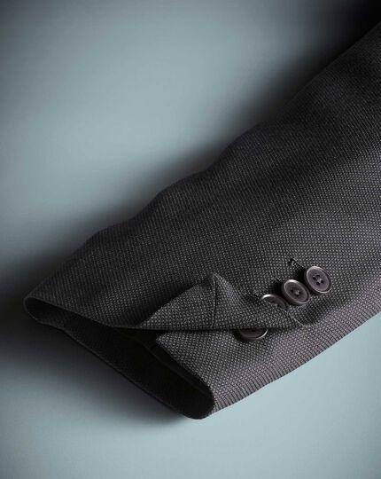 Charcoal slim fit birdseye travel suit jacket