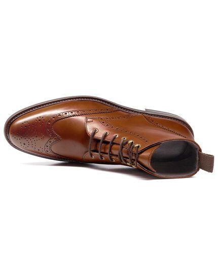 Tan brogue wing tip boots