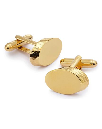 Gold textured oval metal cufflinks