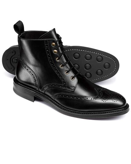 Black brogue wing tip boots