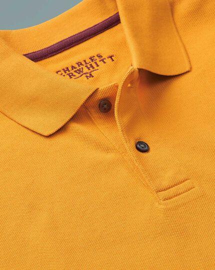 Polo en piqué jaune