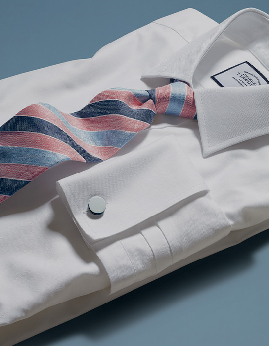 a blue and pink stripe tie on a white shirt