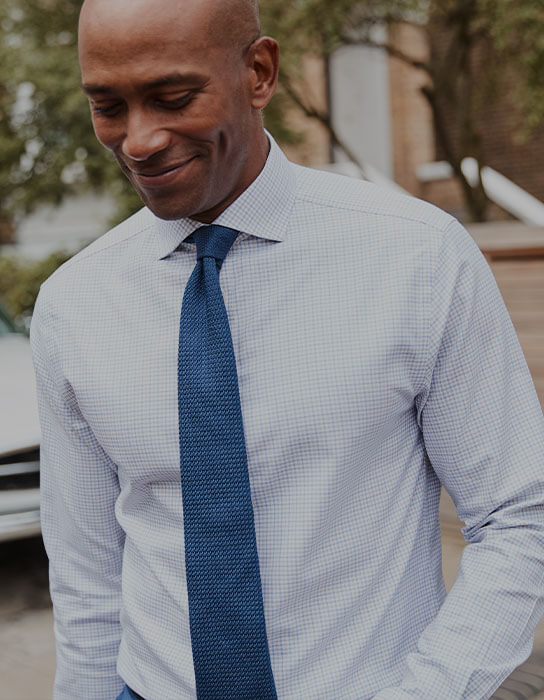 A man in a white shirt and blue tie