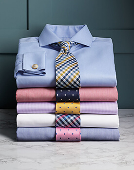 stack of dress shirts