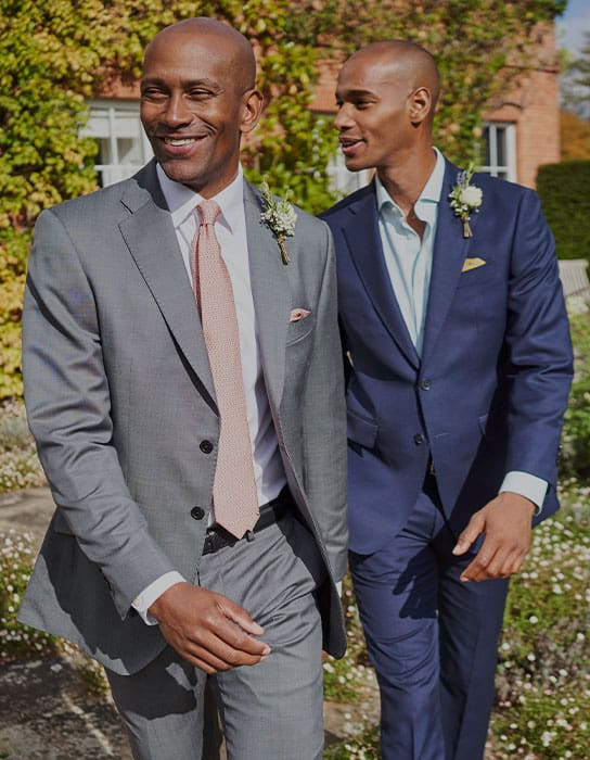 two men wearing an occasion suit
