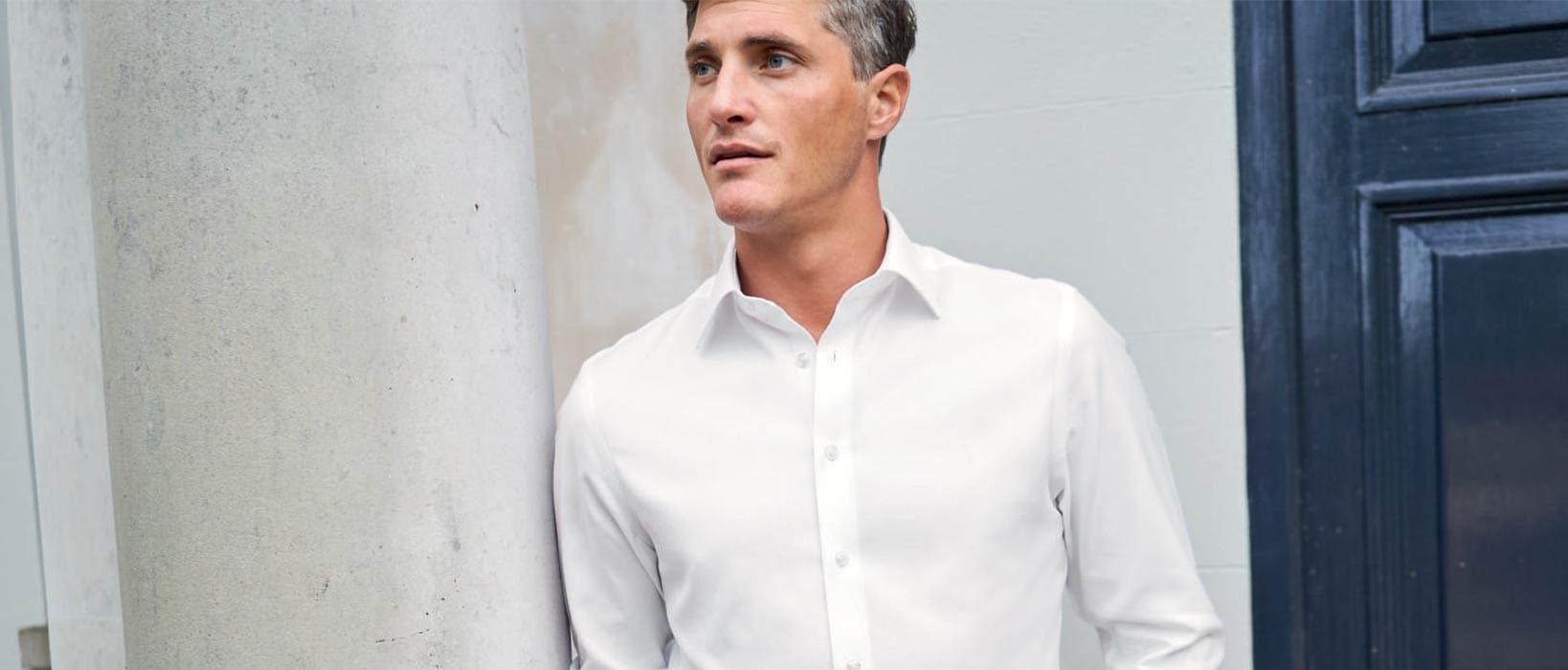man in a white linen shirt