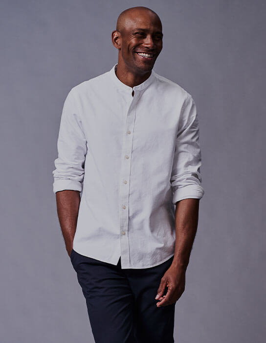A man in a white shirt and chinos