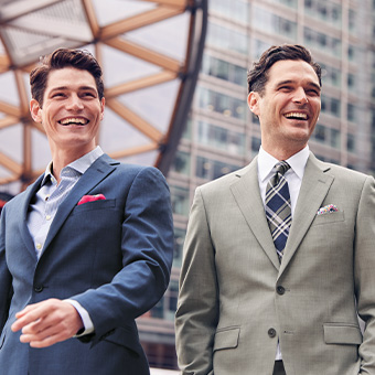 men in blue business suit and grey business suit