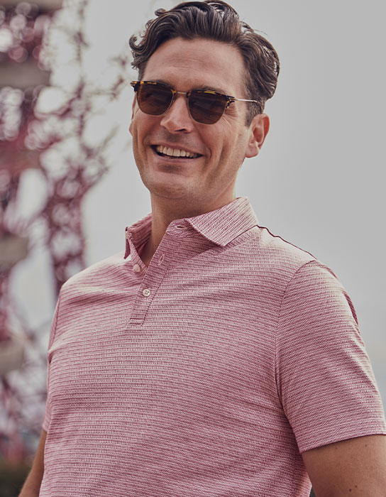 a man in pink polo
