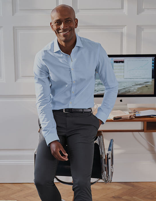 man in grey chinos and a blue shirt