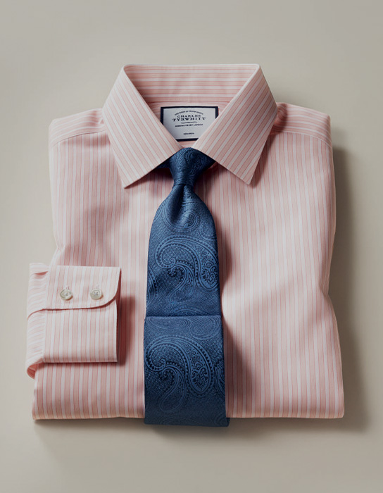 a blue floral tie on a pink shirt