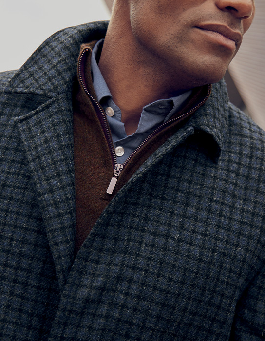 man in grey checked wool coat