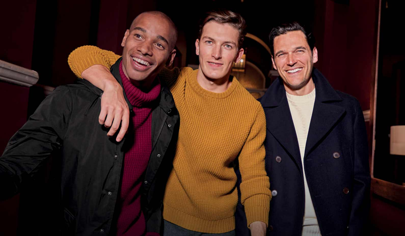 three men wearing chunky sweaters and coats and jackets