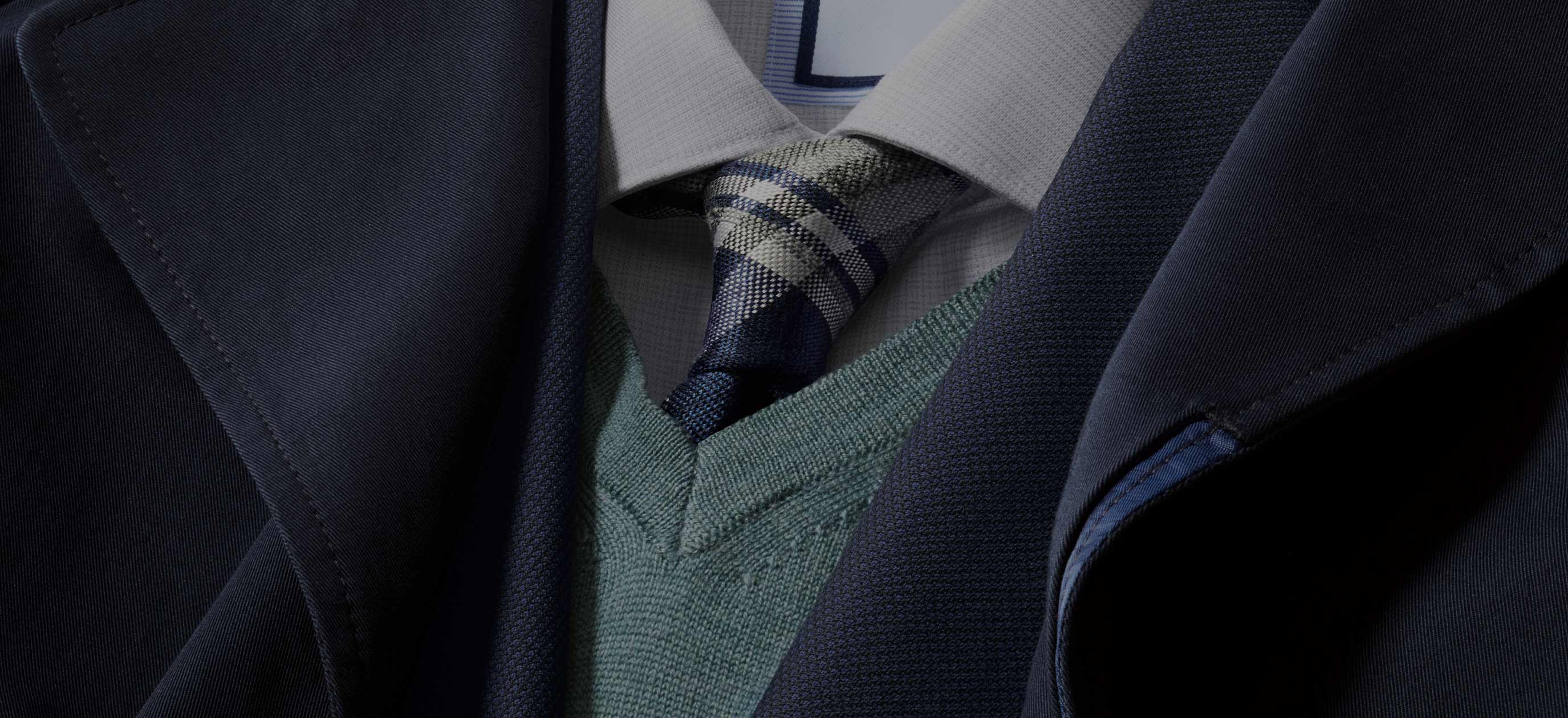 navy jacket and merino jumper with check tie