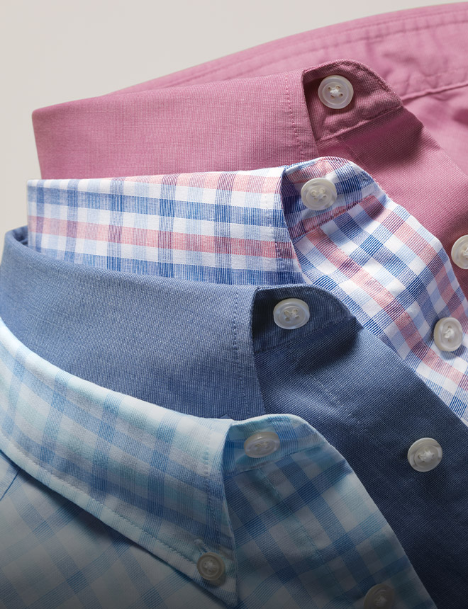 stack of plain and checked button-down collars