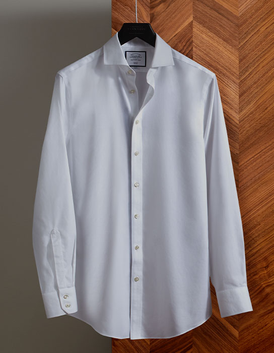 white business shirt on a hanger