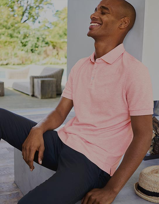 a man in a pink polo