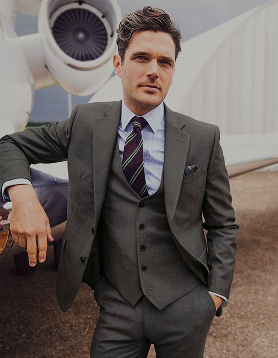 man in grey 3 piece business suit