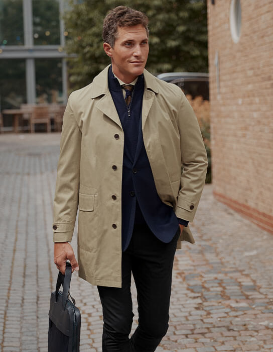 a man in a beige raincoat