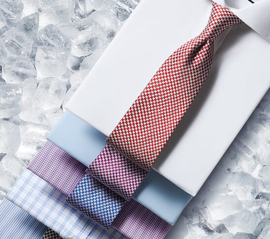 Image of natural cool shirts in different colours: blue, pink, green and orange