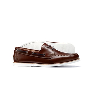 A pair of brown boat shoes