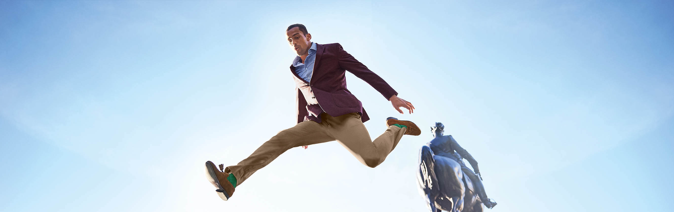 Man leaping over monument