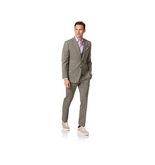 A man wearing a panama suit