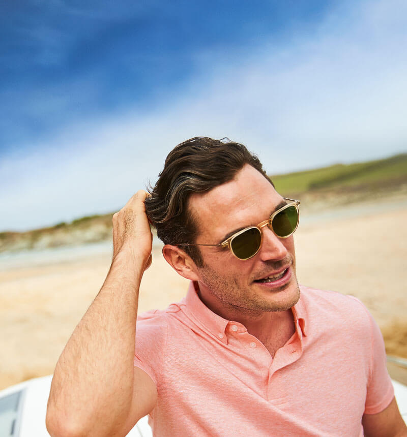 A man wearing a pink polo shirt