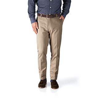 A pair of beige non-iron chinos