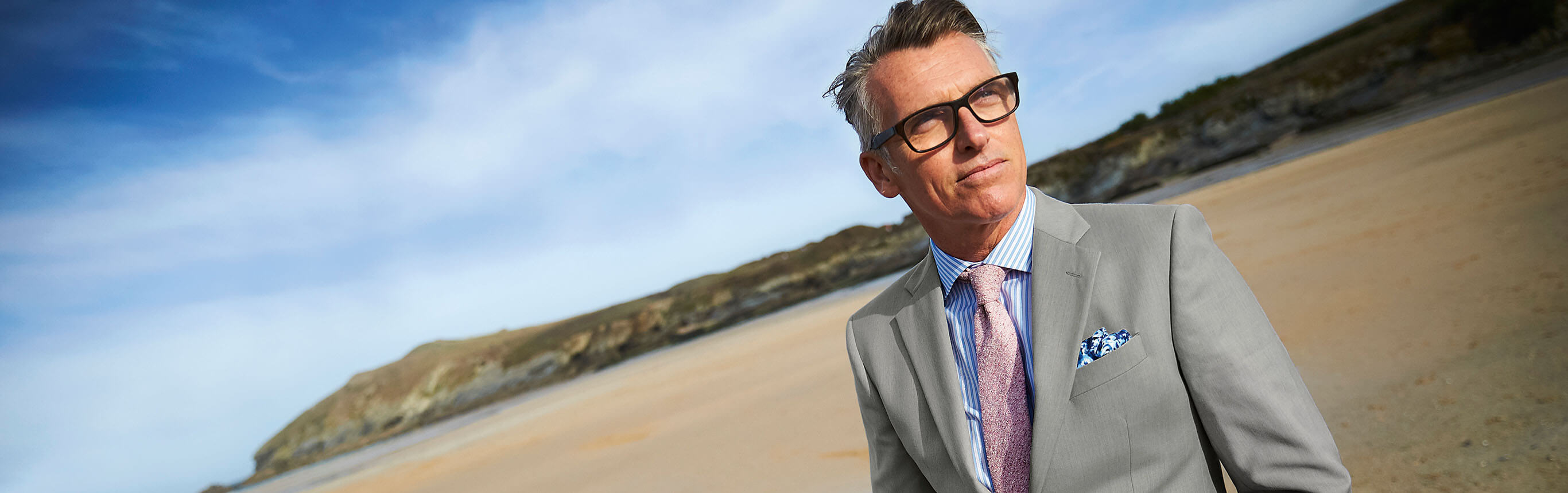 Image of model in suit on beach