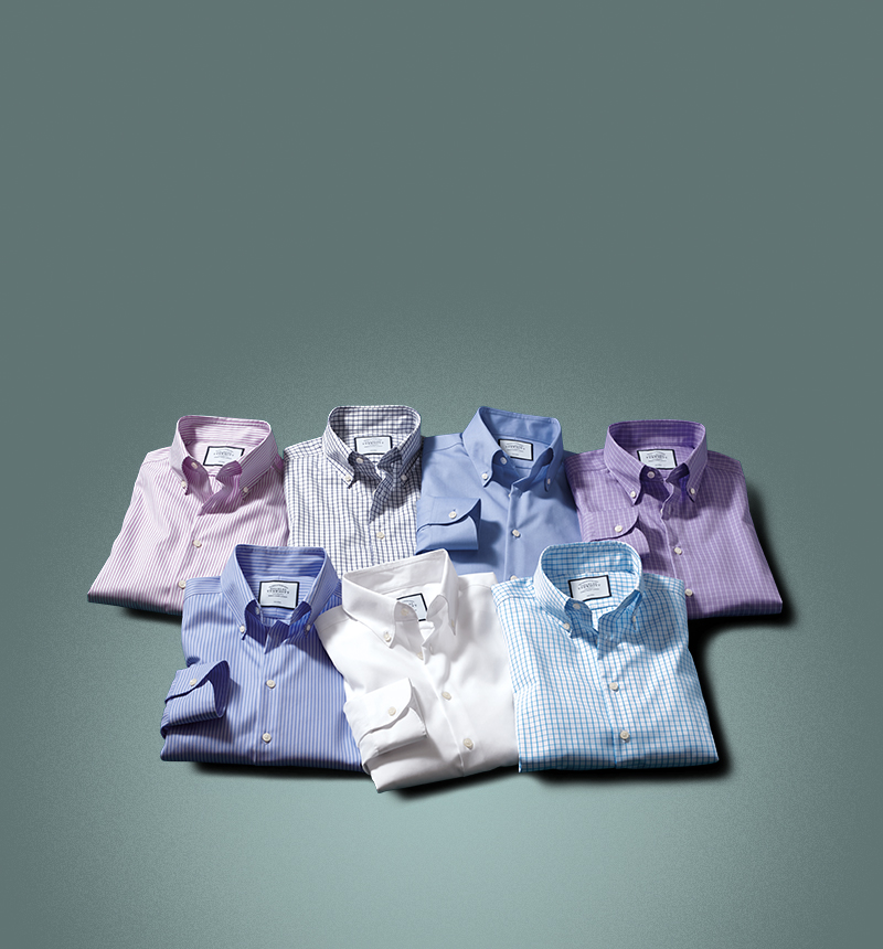 row of 6 shirts on a green background