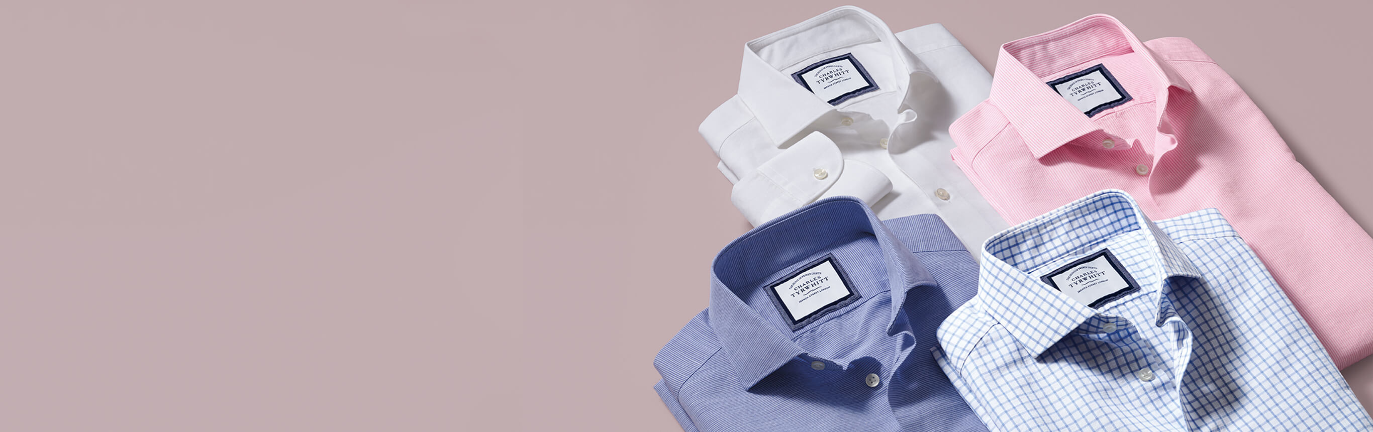 4 business casual shirts against dusky pink background