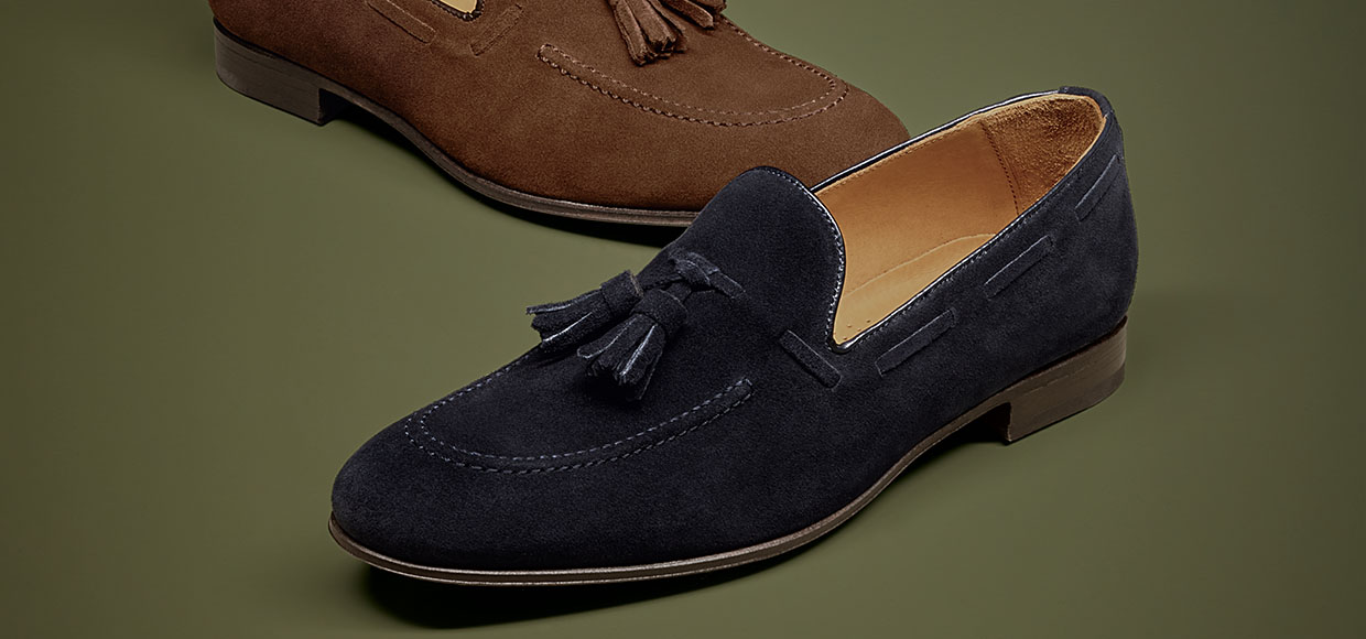 2 different coloured loafer shoes