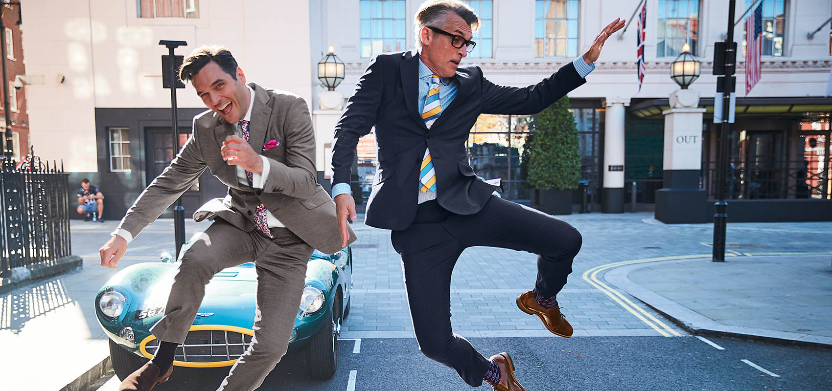 2 models jumping in Suit Trousers
