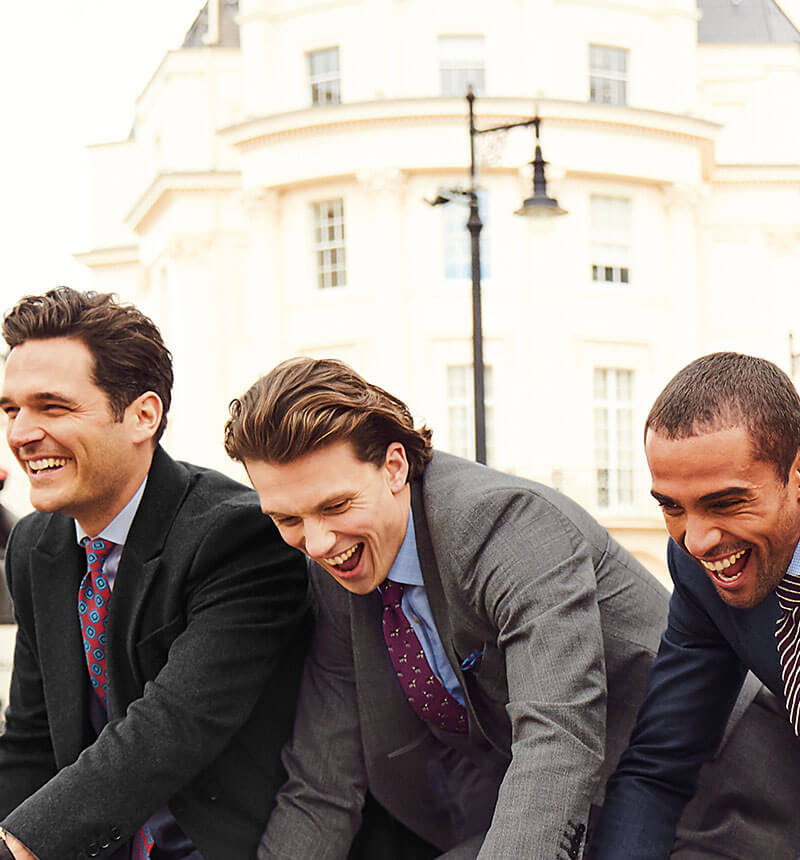 Image of models wearing suits on bikes